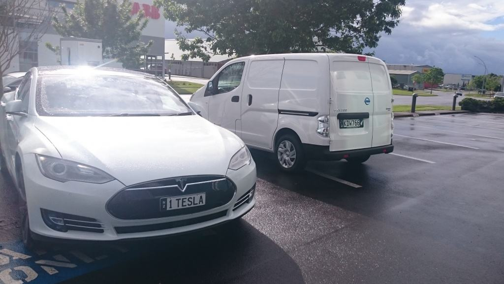 The New Electric van and another white car!